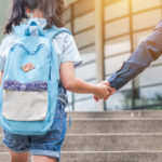 young girl attending new school.jpg.crdownload