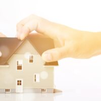 Hand and model house divorce house separation real estate human