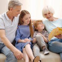 Lively inventive couple entertaining their grandchildren
