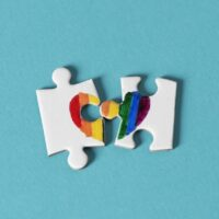puzzle pieces which form a rainbow heart